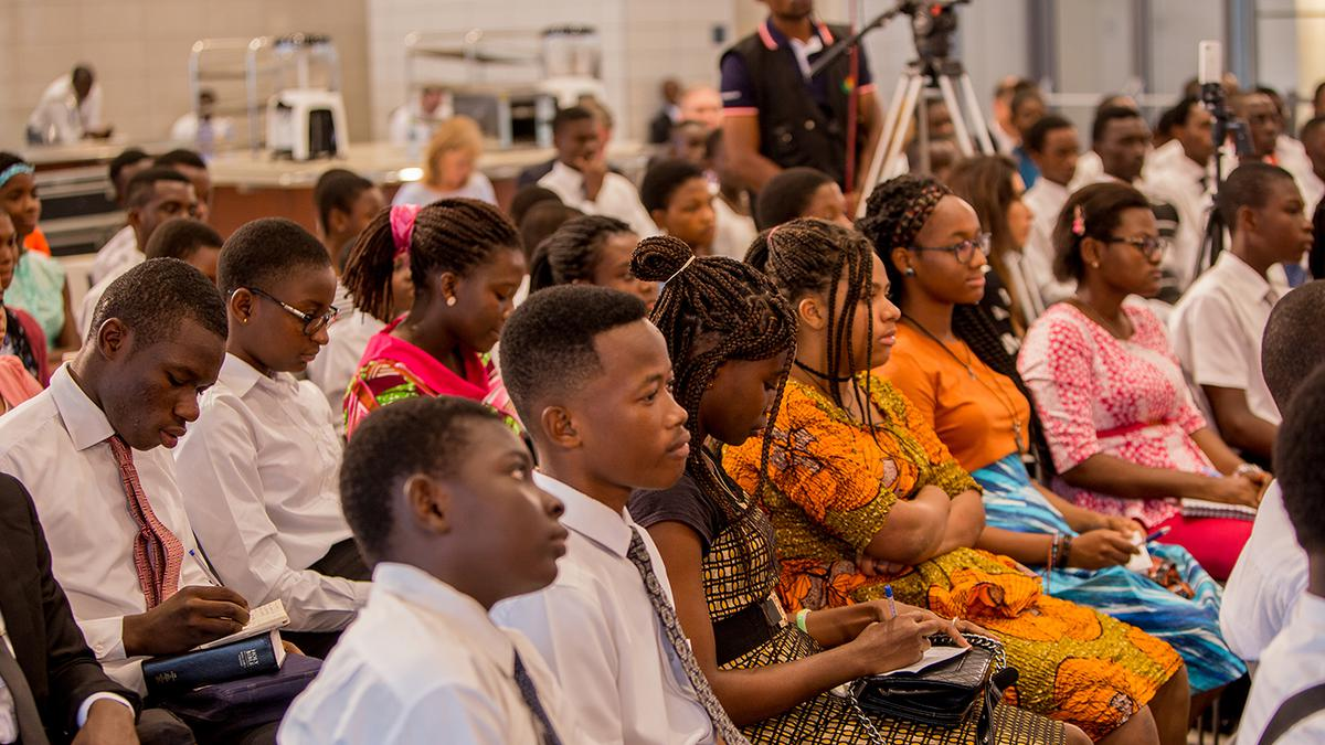 Youth listening to Elder Renlund at Africa Face to Face event in Ghana
