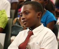 Youth in Ghana listening at Africa Face to Face event