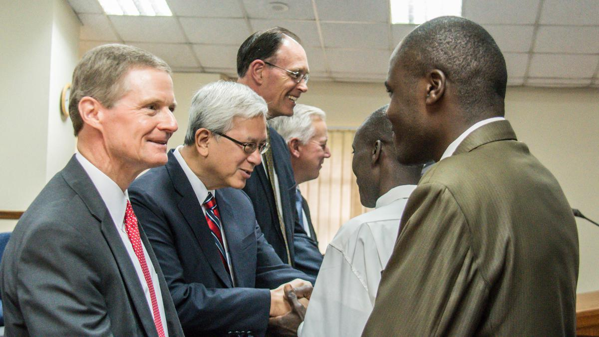 Elder David A. Bednar visiting church members in Africa