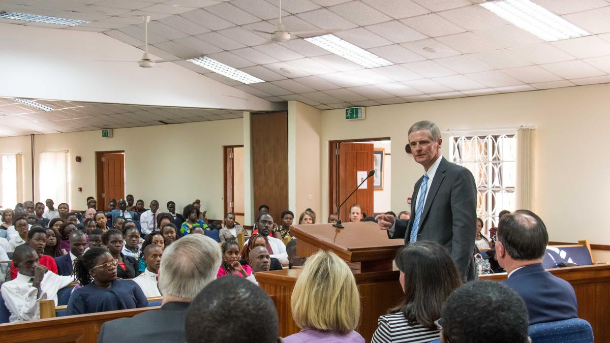 Elder David A. Bednar addressing members in the Africa Southeast Area