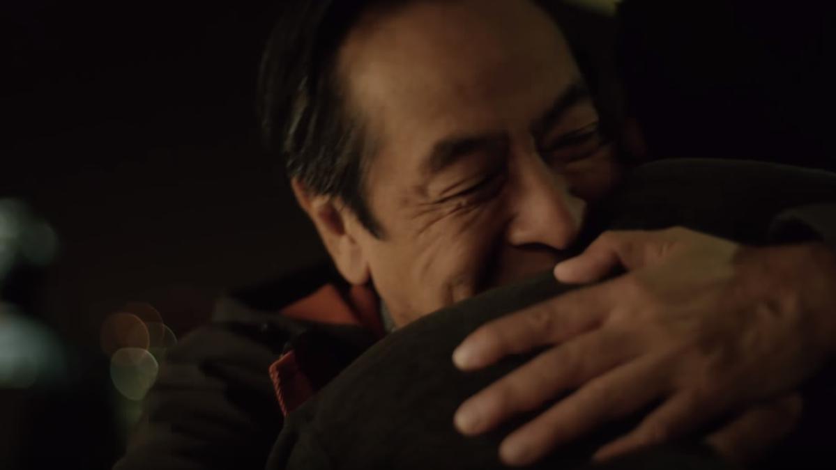 Man hugging his son, showing forgiveness