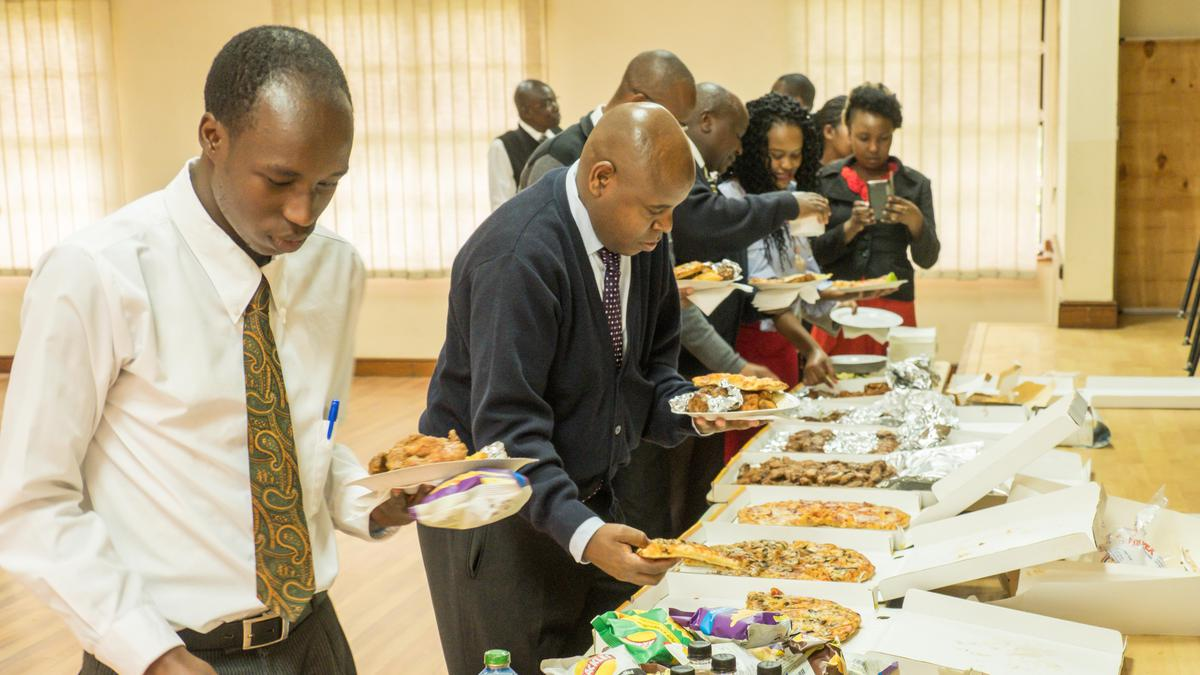 LDS members in Kenya having refreshments at Light the World activity