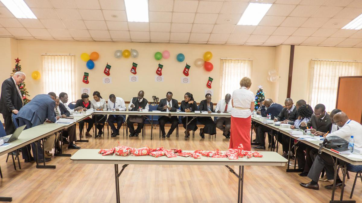 LDS members in Kenya working on a quilt activity for Light the World