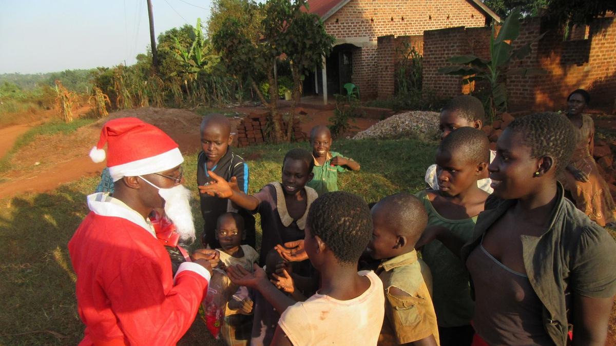 Mormon members from Ntinda Ward in Uganda celebrating Christmas in a local village through service