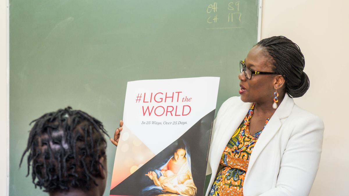Sister Baddoo sharing her Light the World story in church