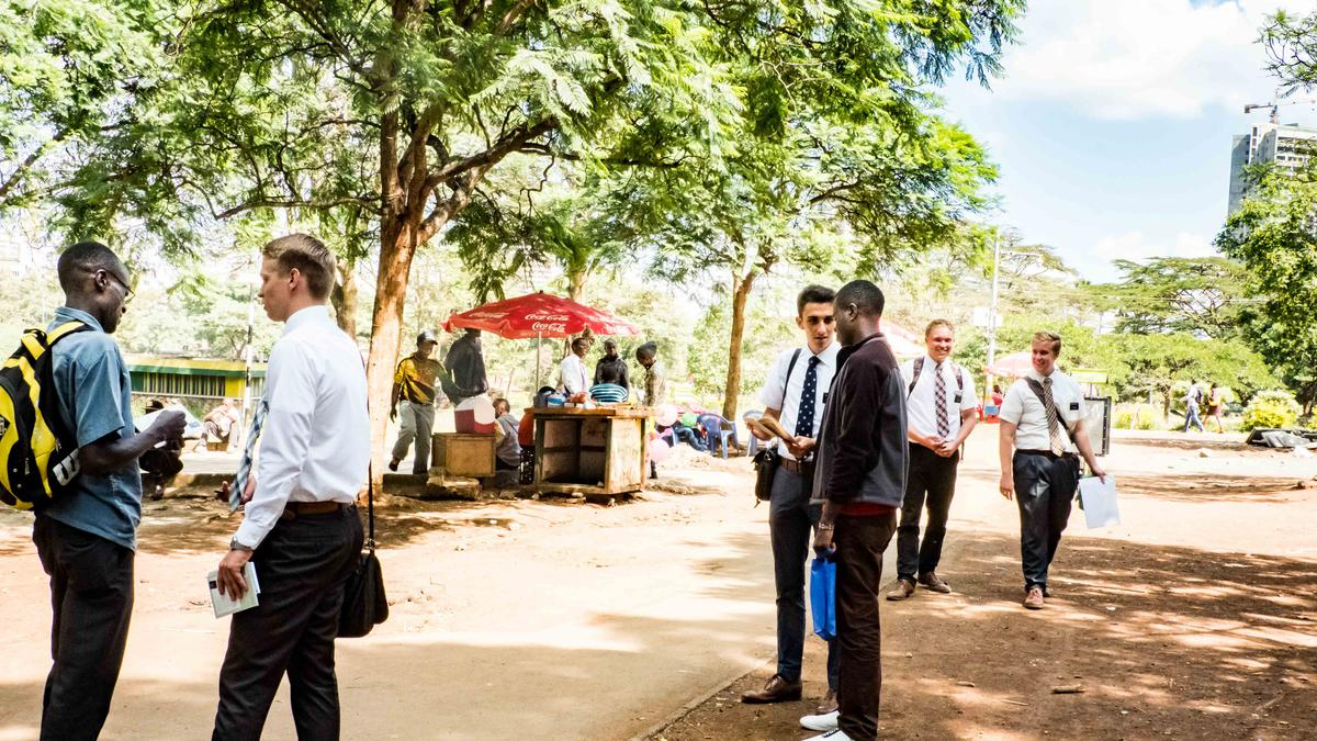 Missionaries gathering contacts after singing in the park