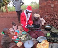 Members of Ntinda Ward in Uganda presenting food parcels