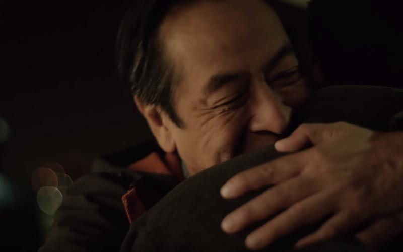 Father hugging his son, showing forgiveness