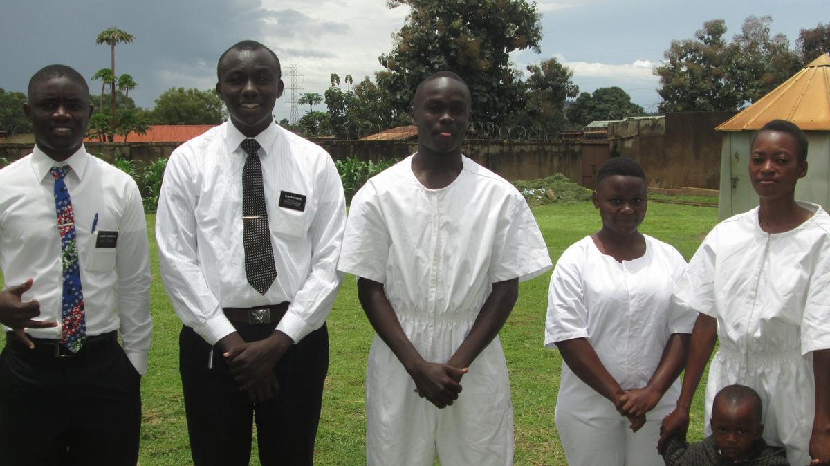 Elder Asante baptising new members in Uganda