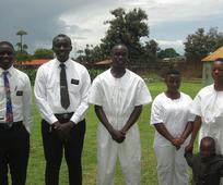 Elder Asante baptising new members in Uganda