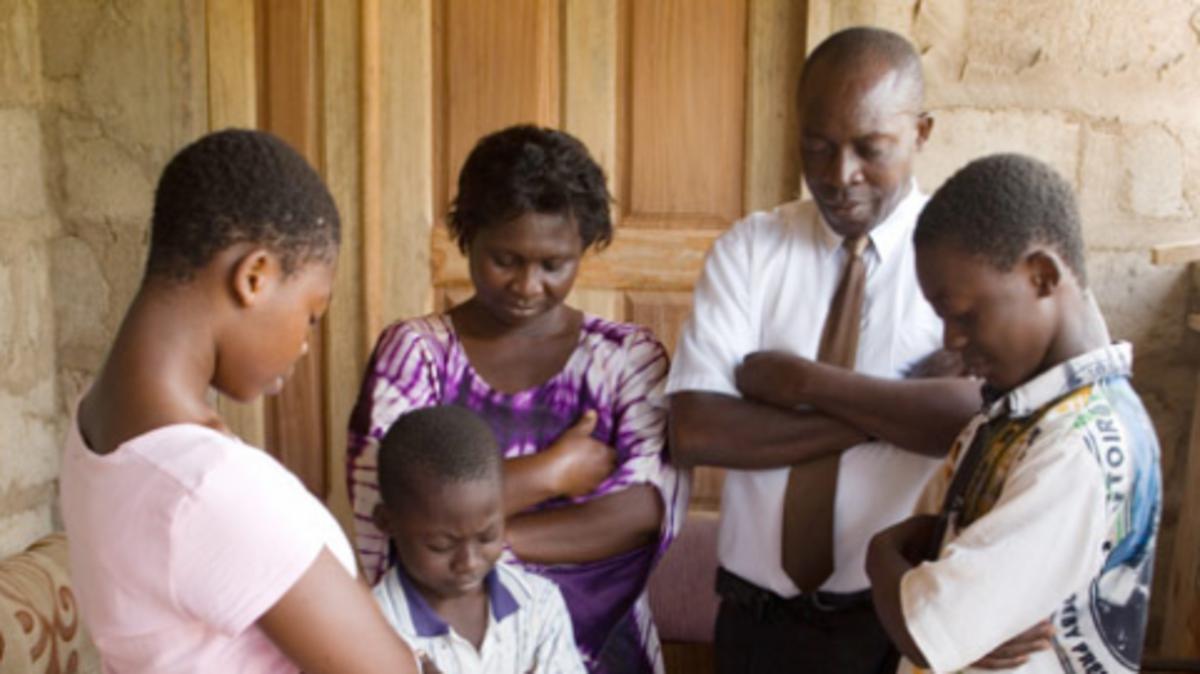 image of family praying