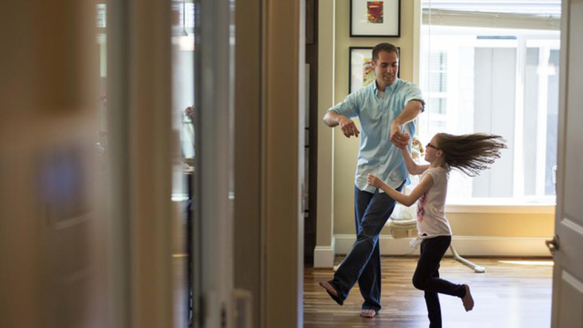 image of father dancing with daughter