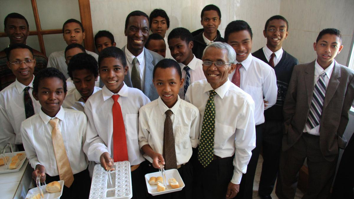 image of young men and sacrament