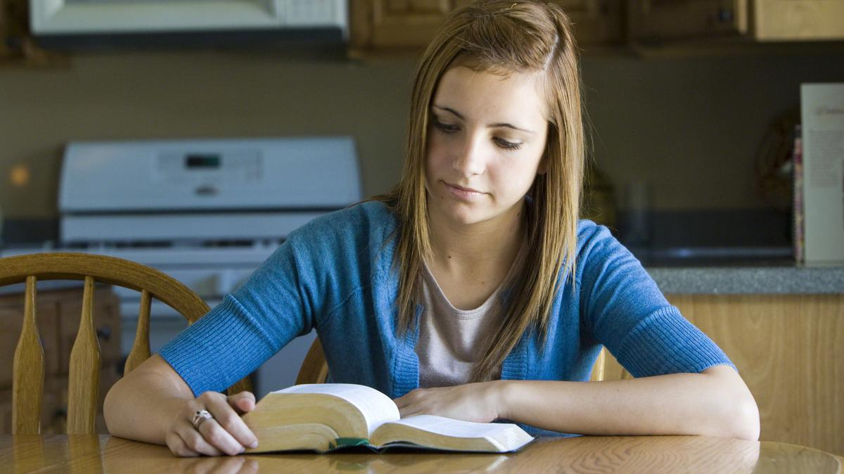 image of girl studying scriptures