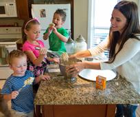 image of mother baking with children