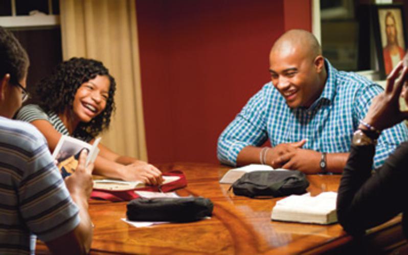Mormon family reading scriptures