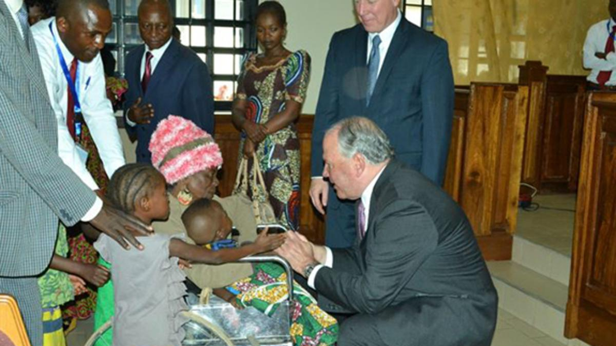 Elder Ronald A. Rasband greets a woman and her family at a member meeting in Likasi, Democratic Republic of the Congo