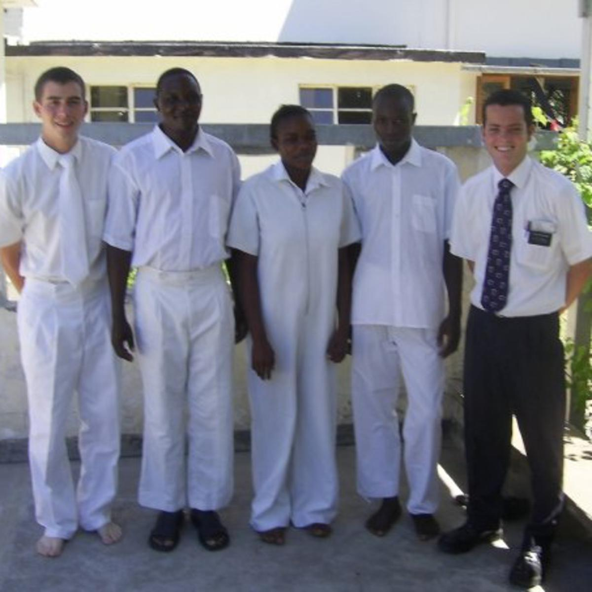 image of missionaries with members to be baptised