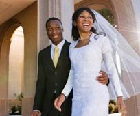 African couple getting married at temple