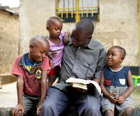 Image of Elder & Sister Renlund & African youth