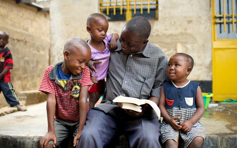 Image of Elder & Sister Renlund & African youth