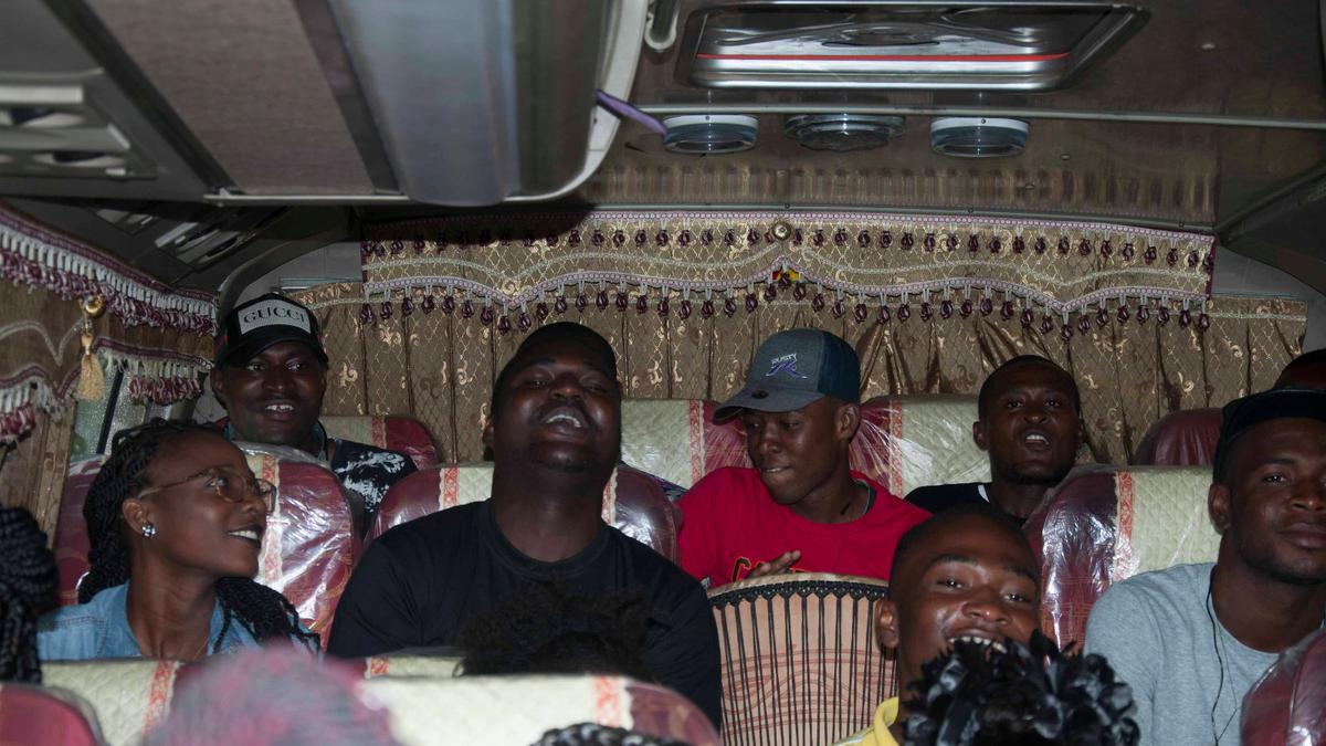 GROUP SINGING IN THE TRIP BUS
