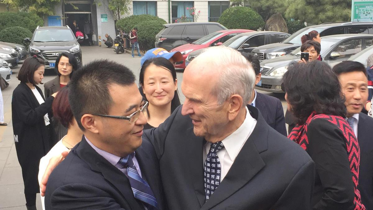 President Nelson with Dr. Li Zhenfeng outside the Shandong University School of Medicine in Jinan, China.