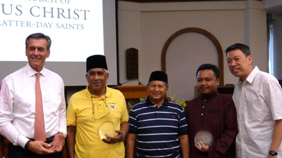 MP Melvin Yong presented a plaque to the head of each of the religious organisations