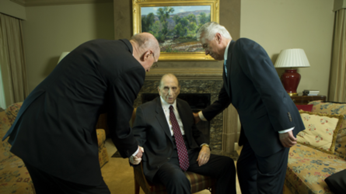 President Thomas S. Monson shakes hands with his counselors, President Henry B. Eyring and President Dieter F. Uchtdorf, on Tuesday, August 15, 2017, in his Salt Lake City apartment as he nears his 90th birthday on August 21, 2017.  Photo by Scott G Winterton, Deseret News.