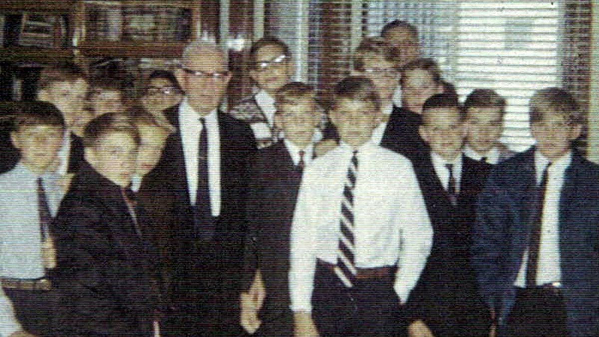 Elder Evan A. Schmutz with a quorum of teachers and deacons meeting Elder Joseph Fielding Smith.