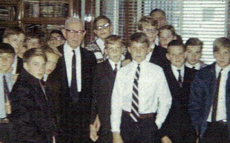 Elder Evan A. Schmutz with a quorum of teachers and deacons meeting Elder Joseph Fielding Smith