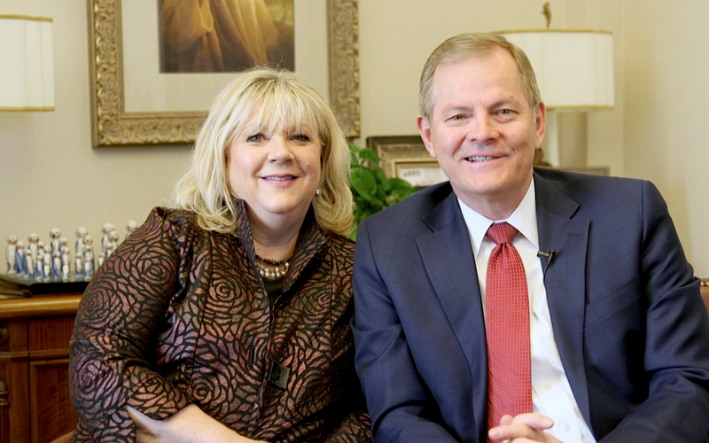 Elder Gary E. Stevenson and his wife, Lesa invites the youth of Asia