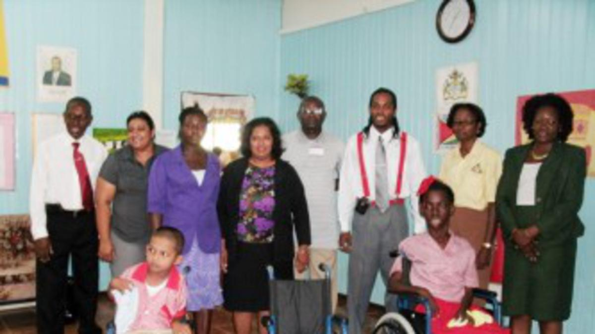 New Amsterdam Hospital presents wheelchairs to crippled children