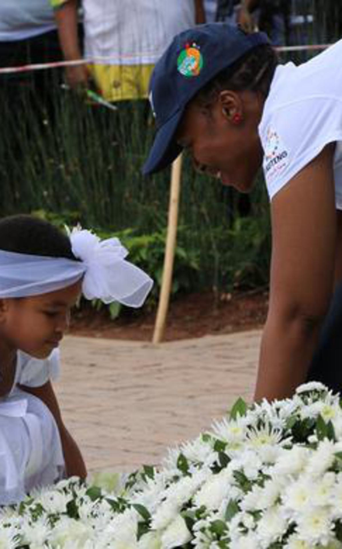 Primary girl placing a wreath