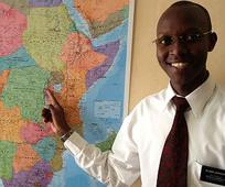 Elder Jackson pointing to Rwanda on the African continent map.jpg