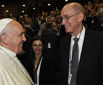 Pope Francis greets President Henry B. Eyring.