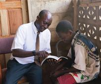 african-father-son-studying-scriptures-208954-wallpaper.jpg