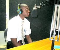 Elder Bryant on the air at the radio station
