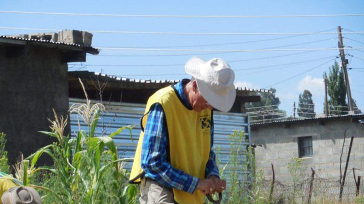 Elder Parnell senior missionary in Lesotho lends a hand with the garden