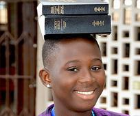 Girl with bible on head