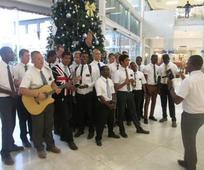 Accra West Missionaries Carol at Mall.jpg