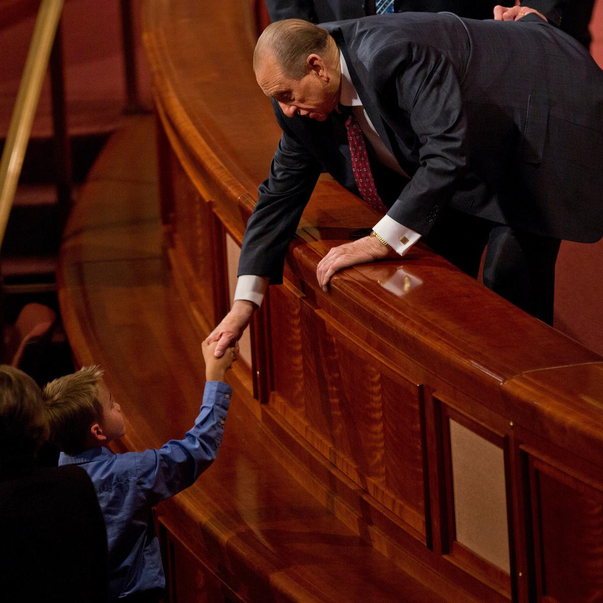 President Thomas S. Monson shakes hands with a boy