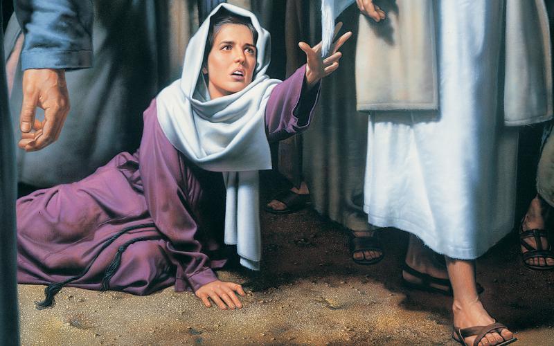 Wanita menyentuh jubah Juruselamat