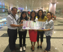 Family picture at Changi airport.png