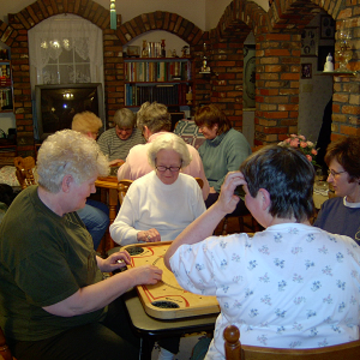 Ladies playing crokinole