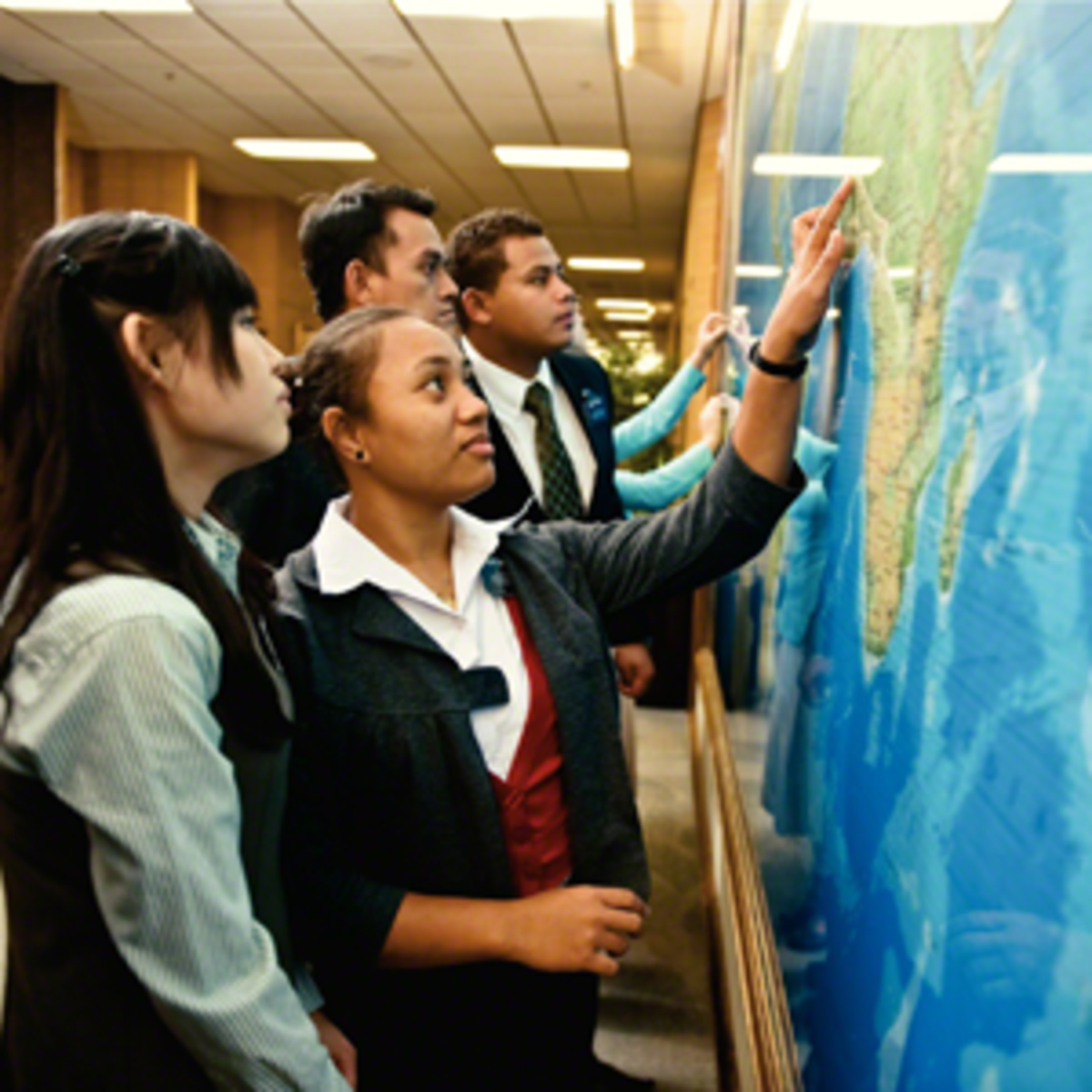 Missionaries at a map