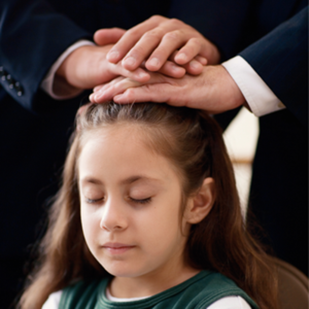 Young Girl being Confirmed a member of The Church of Jesus Christ of Latter-day Saints