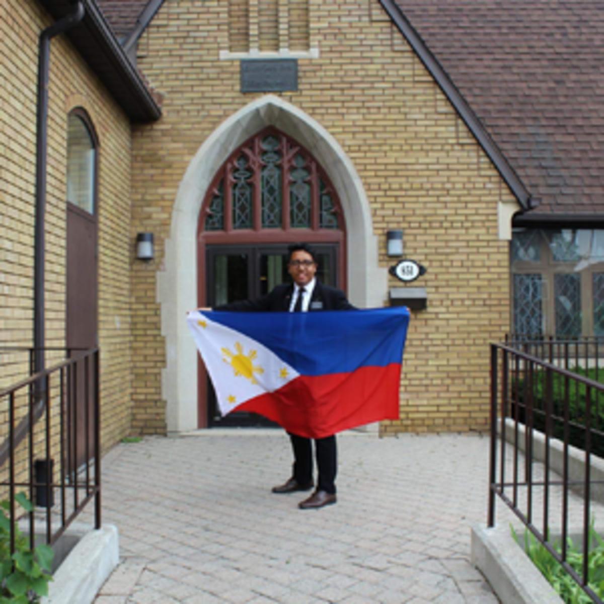 Elder Bagtas with flag