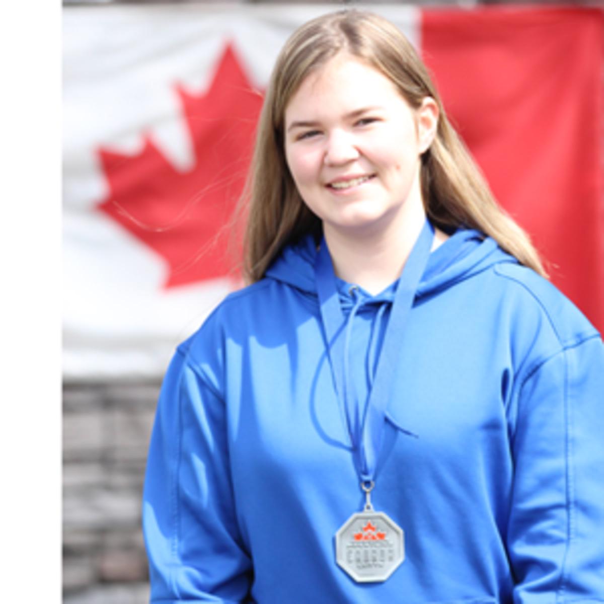 Maren with her medal