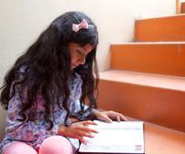 girl-reading-stairs-1201055-gallery.jpg